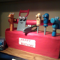 Handy Manny Birthday Cake  Cake ends and tool box handle are covered with 50/50, sides are plain fondant. Tools are made from gumpaste. Board is also covered with 50/...