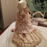 Wedding Dress Cake  This is a cake I just won 1st place in the Knoxville Great Cake Bake today.The dress form is made of RCT covered in fondant and the skirt...