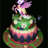 My Little Pony Birthday Cake two tiered cake, covered in fondant, and little pony figure on top. It is a portable nightlight.