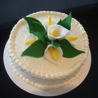 Easter Cala Lily Cake Vanilla cake and vanilla buttercream. Fondant flowers and leaves.