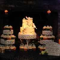 Doves & Cupcakes This two tier is frosted with cream cheese and decorated with fondant vines & flowers. Cake Central's own AnnaBakesCakes made the...