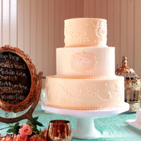 Lace & Monogram The top & bottom tiers were frosted with champagne buttercream and decorated with lace from the bride's gown. The monogram was...