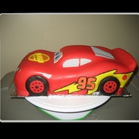 Cars Lightning Mcqueen  This was for my son's 2nd birthday! It was chocolate cake with chocolate buttercream, covered with fondant. The wheels were made out...