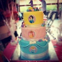 Disney Princess 1St Birthday Cake  A disney princess themed cake for a first birthday. This is not my original design. A friend of mine found it online and sent me the...
