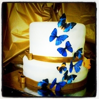 Golden Blue Butterfly Wedding Shower The theme for the wedding is royal blue and gold with butterflies. The cake is actually a royal blue velvet cake with cream cheese frosting...