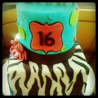 Zebra Print With Blue Green And Pink  A 16th Birthday cake fit for a teenager into zebra prints and bright colors. The celebrants favorite pattern/print was zebra and her...