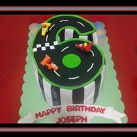6 Race Track Cake Race Track cake in the shape of the number 6. This was for my Godson's 6th birthday. Chocolate fudge cake with chocolate buttercream,...