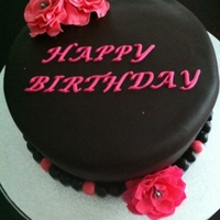 Flower Birthday Cake Dairy and Egg Free Chocolate Cake decorated with Dark Chocolate fondant and Fondant Flowers