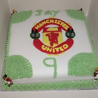 Manchester United Birthday Cake Fondant covered sponge cake, with butter cream and strawberry jam filling