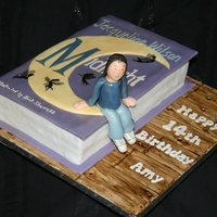 "Cake Of The Book ""midnight"" By Jacqueline Wilson My first book cake - ""Midnight"" with a little 3D character to make it more fun.The silhouette fairies were hand painted."