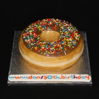 "Donut (Or Doughnut) Cake  Modelled on the Krispy Kreme donut, this cake started out as a regular 8"" cake which I carved into the right shape, after filling with..."