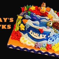 Finding Nemo Themed Cake Chocolate Cake with Strawberry ButtercreamAll Decors are edible except for the candles