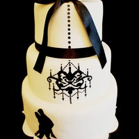 Hand Painted Chandelier Wedding Cake I dont know whom to give credit to, but it was inspired by a cake i saw online and made modification with the silhouette couple. 3-tier...