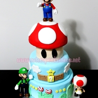 Super Mario Cake   I made this Super Mario themed cake for my husband (by special request)....yes they never quite grow up