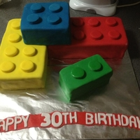 Lego Blocks  These were lego bricks/blocks covered in coloured fondant...the pegs were just cut out of fondant too. Each colour brick was a different...