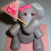 Fondant Elephant  This little gal sat atop a plain jane vanilla cake with vanilla frosting for a friend's going away party (she got a job at an elephant...