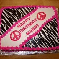Zebra Stripe & Hot Pink Birthday Cake Buttercream icing with fondant zebra stripes. Accented with hot pink.
