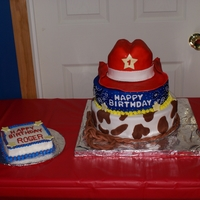 Cowboy Birthday Cake This is my Nephew's first birthday cake. Bottom layer is cow print, middle is blue bandana and top is cowboy hat with gumpaste brim.