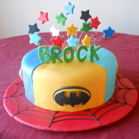 5 Superheros In 1 There are 4 superheros on the cake. Batman, Superman, Captain America, and Iron Man. Spiderman's web is for the base and letters for...