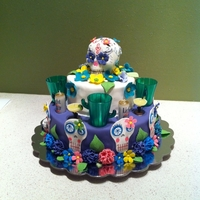 Cinco De Mayo/day Of The Dead Birthday Fondant covered cake with gum paste flowers and skulls. The skull on top is a true sugar skull.