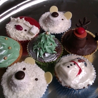 Christmas Cupcakes   Chocolate & Vanilla cupcakes, topped with a variety of designs.