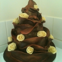 First Ever Chocolate Wrap This is my first ever two tier cake and my first ever chocolate wrap cake. It started out as a complete disaster as I made my own modelling...