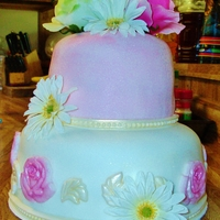 Happy Anniversery a two layer strawberry cake, covered in pink and white fondant, with gold and pink fondant accents.