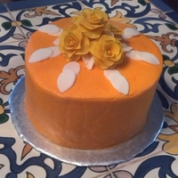 Birthday Cake With Rose Orange buttercream icing with matching roses. I added butterscotch liqueur to the icing. Added a nice different flavor to it.