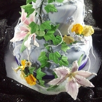 My First 2-Tier Cake Took a Wilton Tall Cakes Class and this is the results of my first 2-tier cake.
