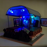 I <3 One Direction One Direction stage cake, lights up with LED lights. Cake is raised from board and has a foamboard roof and side screens. Edible 1D boys...