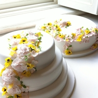 Bridal Cake June 2012  Cakes: Chessnut, buckwheat, almond & wheat. Filled with blackthorn jam. Decorated with superpaste flowers, perfumed with rosewater,...