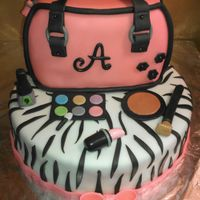 "Girl's Birthday Cake Girl's Birthday Cake The cake is a 10"" round chocolate cake with chocolate buttercream. The purse is an 8"" round chocolate..."