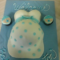 Its A Boy!! Chocolate fudge cake with vanilla butter cream pregnant belly cake and baby boy cupcakes.