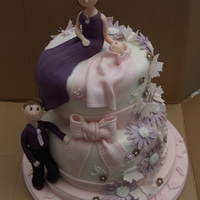 Christening Cake With 3D Figures Of Mum Dad And Baby