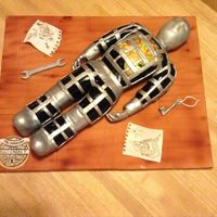Hugo Cabret This is a cake I made for competition. Sadly it didn't reach an award but I was proud of my effort anyway.