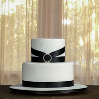 Elegant Black And White Wedding Cake Elegant, black and white wedding cake with diamante clasp detail. It is only a dummy cake for my website