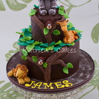 Safari Cake Chocolate mud cake with modeling chocolate collars and leaves, as well as gum paste safari animals.