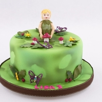 Garden Fairy Cake Vanilla Buttercake with a vanilla white chocolate ganache filling decorated with leaves, bees, mushrooms and a fairy.