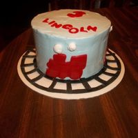 Train Themed Chocolate cake with wilton whipped icing and fondant accents.