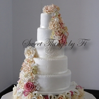 Floral Cascade With Monogram Sugar flowers with fresh floral base and monogram of the bride and grooms initials