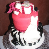 Zebra Striped Wedding Shower Cake The theme of the wedding shower was zebra and cheetah print. We did a zebra striped two tiered cake with a fondant wedding dress and an...