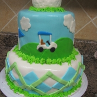 Golfing Cake Two tiered fondant covered golfing cake.