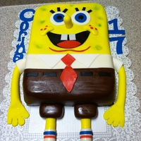 Spongebob Cake made this cake for my baby sister who loves spongebob.... triple chocolate fudge cake with vanilla pudding filling and fondant.