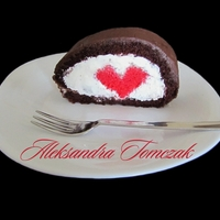 Cake Roll With Red Heart This is my another experiment with red heart instert. Red velvet heart, whipped cream, chocolate mud cake covered with chocolate ganache....