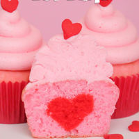 Heart Filled Cupcake For Two. A pretty pink cupcake with a pretty pink swirl of buttercream and a special red heart baked inside! Check out the full tutorial here:http...