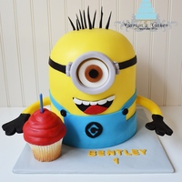 3D Minion Cake Made for one of my best friends cute little boy who turned 1! He loves the movie Despicable Me. White cake and jumbo cupcake with vanilla...