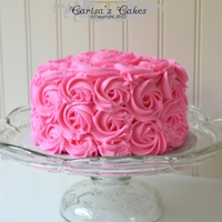 "Rose Swirl Smash Cake 6"" white cake with cherry-almond buttercream."