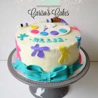 "Little Artist Cake 8"" white confetti cake with almond-cherry buttercream and hand cut fondant accents."