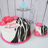 "Zebra Stripes Original Design 10"" and 4"" cakes. White cake with vanilla buttercream and fondant accents. My client wanting something a little different than..."