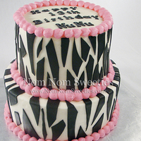 Zebra Birthday Cake Buttercream with modeling chocolate zebra stripes.